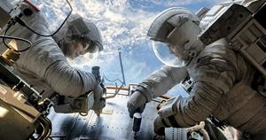 Sandra Bullock and George Clooney, brought down to Earth by space junk in the film Gravity