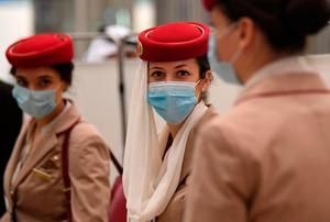 Stewardesses of an Emirates Airlines flight from London arrive at Dubai International Airport amid the coronavirus Covid-19 pandemic. Photo: AFP via Getty Images