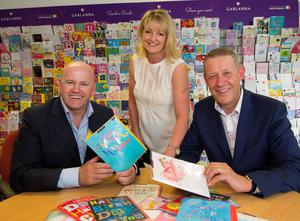 Sean Gallagher with Jackie and Alan MacNamee of Garlanna Greeting Cards. Photo: Mary Browne