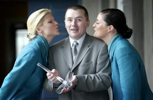WILLIE WALSH, CEO , AERLINGUS PICTURED WITH AERLINGUS GROUND STAFF,EVADNE COOGAN AND  AISLING O BRIEN, AFTER AER LINGUS  SCOOPED THE CHAMBER OF COMMERCE OF IRELAND S AIRLINE OF THE YEAR AWARD 2003  AND  BEST VALUE FOR MONEY AWARD,AT DUBLIN CASTLE YESTERDAY.