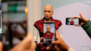 Attendees take smartphone photographs of humanoid robot 'Sophia' at Barcelona's MWC – research has found some towns could lose almost 60pc of jobs to automation. Photo: Bloomberg