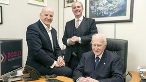 Sean Gallagher with Tim Dooley, managing director of Dooley Insurance group, and his father Ned. Photo: Mark Condren