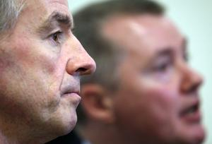 Michael O'Leary, chief executive officer of Ryanair Holdings Plc, left, listens as Willie Walsh, chief executive officer of International Consolidated Airlines Group SA (IAG), speaks during a news conference in London, U.K., on Thursday, Nov. 17, 2011. Ryanair Holdings Plc, EasyJet Plc, Virgin Atlantic Airways Ltd. and British Airways-owner IAG called on the U.K. to scrap an aviation tax they say is hurting the economy to a degree that outweighs the revenue raised. Photographer: Chris Ratcliffe/Bloomberg