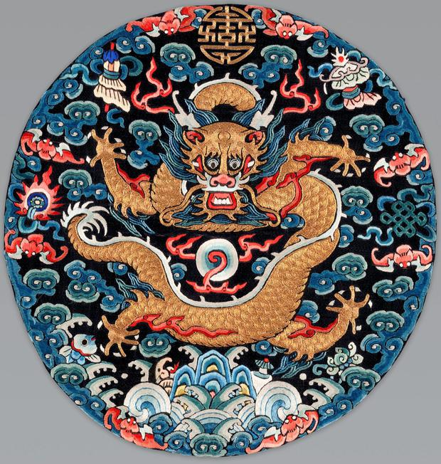 An imperial dragon insignia designed to be worn on a men's surcoat during the Late Qing Dynasty, circa 1875-1900. The badge is embroidered with silk and gold thread on silk, and its owner was very powerful-only men in the extended imperial family through prince of fourth rank were permitted to wear these dragon insignia. The more badges they wore, the more powerful they were.