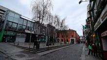 Taking a hit: A deserted Temple Bar in Dublin on St Patrick's day yesterday. The tourism sector is set to suffer huge losses