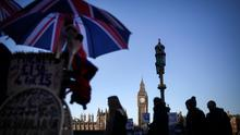 Tourists walk past a souvenir stall on the south bank of the River Thames in view of the Houses of Parliament in London (Bloomberg)