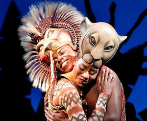 Cast members perform a scene from Disney's The Lion King