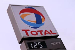Pumping: Petrol price is displayed on a board below the Total logo in Abuja, Nigeria