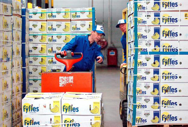 Fyffes has scored a major victory in the battle to merge with banana giant Chiquita after shareholders rejected a rival bid for the US firm