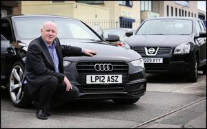 Motoring ahead: Richard Smith,  co-owner and MD  of UK Car Imports  in Baldoyle. Photo: Steve Humphreys.