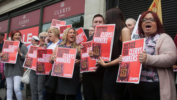 Clocking off: Staff and supporters outside Clerys on O'Connell Street, Dublin this week, after the company went into liquidation. Photo: Gareth Chaney, Collins