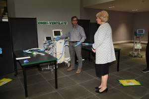 Innovation: Coombilift engineer Antonio Patacho demonstrates the ventilator splitter to Heather Humphreys Photo:  Philip Fitzpatrick