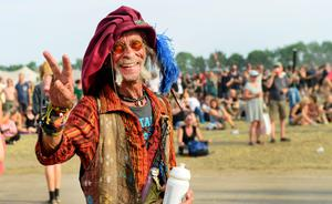 Festival-goer Bibi from Germany, who attended the festival for the past 25 years, gestures during Jamaican singer Barrington Levy's performance on the Orange Stage during the Roskilde Festival in Roskilde, Denmark July 4