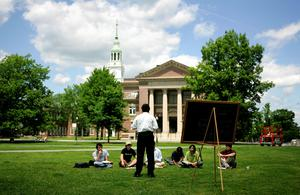 A group of students meet on the lawn outside Webster Hall on the campus of Dartmouth College