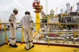 Exploration: Workers aboard a Tullow Oil platform