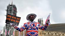 Flying the flag: A Brexit supporter celebrates in London