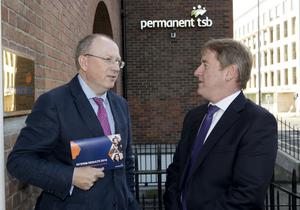 Jeremy Masding, left, is passing the CEO torch to Eamonn Crowley at a turbulent time for Permanent TSB