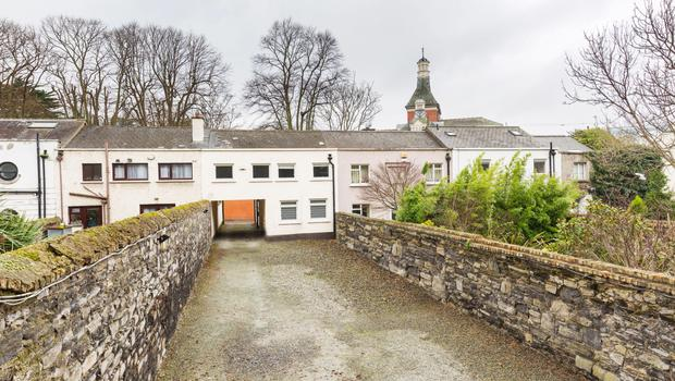 The mews building at 44 Leeson Place is included in the sale