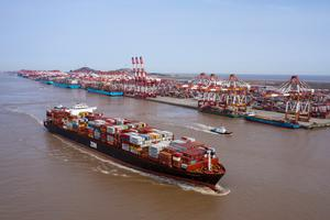 Recovery: A container ship departs the Yangshan Deepwater Port in Shanghai as China ramps up production following the coronavirus outbreak