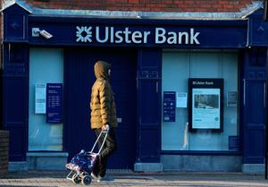 A man passes an Ulster Bank branch in Raheny, Dublin. Photo: Brian Lawless/PA Wire