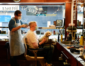 Haircuts ahead: Barber Alan Kelly attends to customer Anthony Remedy at the Regent Barber Shop in Dublin. Photo: Getty Images