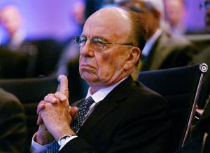 "News Corporation Chairman and CEO Rupert Murdoch listens to morning discussion session during the Wall Street Journal CEO Council on ""Rebuilding Global Prosperity"" in Washington, in this November 17, 2009 file photo. Efforts in Australia to drive forward new laws scrapping media ownership limits have more to do with a rival trying to paint Prime Minister Tony Abbott in a bad light than a genuine push for change. Analysts and industry"