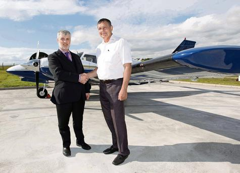 AFTA vice-president Allen Field and Captain Mikhail Batayev, manager of Air Astana operational training