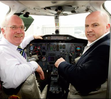 FLIGHT PLAN: Keith Trower, left, founder and chief executive officer of AeroMedevac air ambulance service, with Sean Gallagher.