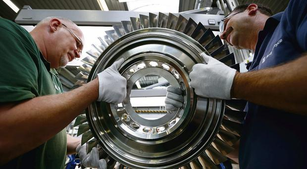Technicians at work in a Rolls-Royce factory