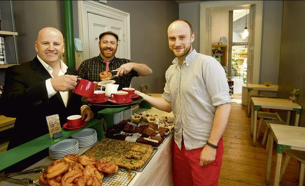 DELI-CIOUS: Sean Gallagher samples the fare at Garrett Fitzgerald and James Boland's Brother Hubbard cafe on Capel Street, Dublin. Photo: Gerry Mooney