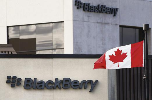 High flyer: A Canadian flag waves in front of a Blackberry logo at the Blackberry campus in Waterloo