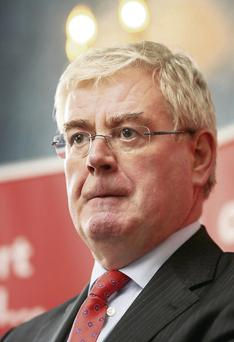 Tanaiste Eamon Gilmore admits that council houses are lying idle
