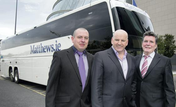 Driving Force: Sean Gallagher with Noel (left) and Paddy Mathews, Matthews Coach Hire, one of Ireland's largest coach hire firms. Photo: Tony Gavin