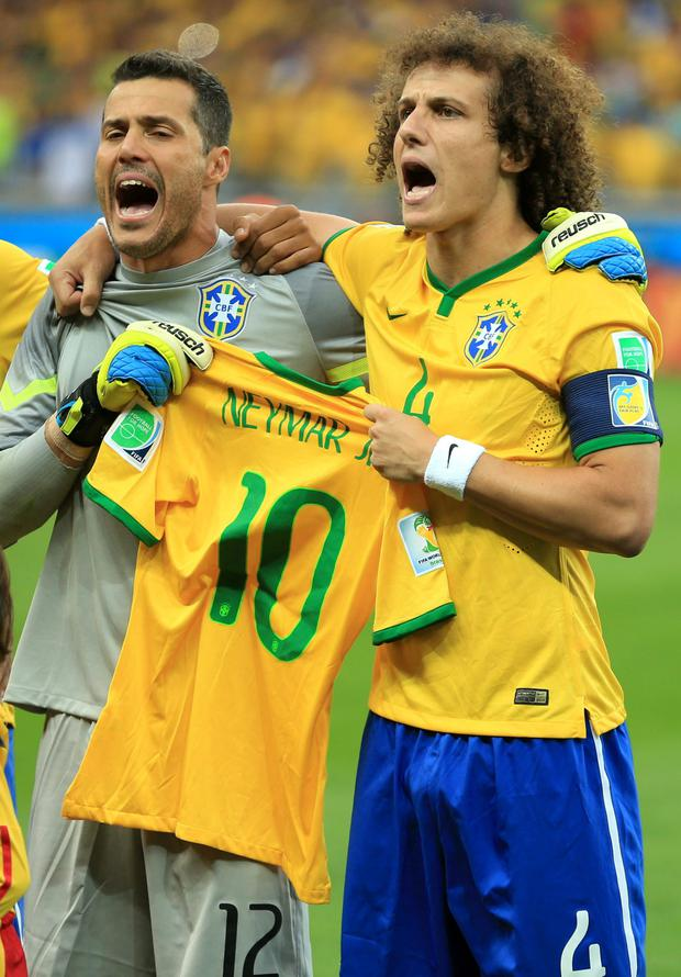 HEROES WILL ONLY GET YOU SO FAR: Brazil's Julio Cesar and David Luiz hold up the shirt of injured teammate Neymar before the World Cup semi-final in which they were thrashed 7-1 by Germany. Photo: Mike Egerton/PA