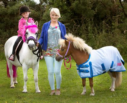 MY LITTLE PONY: Caroline Mullen of Little Hoofs with her daughter Carla and ponies Snowy and Flash at Castletown, Co Wexford. Photo: Tony Gavin