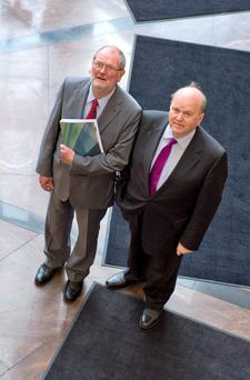 NTMA chief executive John Corrigan and Finance Minister Michael Noonan at the publication of the NTMA's Annual Report for 2013 at Treasury Buildings.