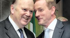 Minister for Finance Michael Noonan with Enda Kenny (right)