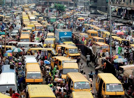 MODERN HEADACHES: Sub-Saharan Africa has enjoyed a remarkable turnaround, and a congested street in Lagos brings more benefits than bellyaches