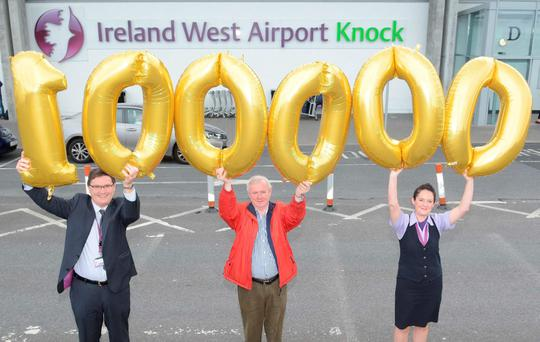 Celebrating the 100,000th passenger through Ireland West Airport Knock Airport in the month of August, a record for the airport, was left to right, Joe Gilmore, Managing Director, Ireland West Airport Knock, Philip McGlynn, Bundoran, Co. Donegal (100,000th passenger) and Sarah Rowley, Head of Airline and Customer Airline Services, Ireland West Airport Knock