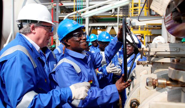 Tullow Oil Ghanain staff celebrate the pumping of oil from the Jubilee field off the coast in Ghana West Africa.