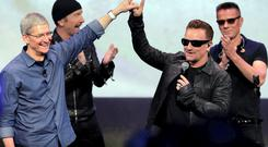 SEEDS OF CHANGE?: Apple's Tim Cook and U2 announce the free download deal