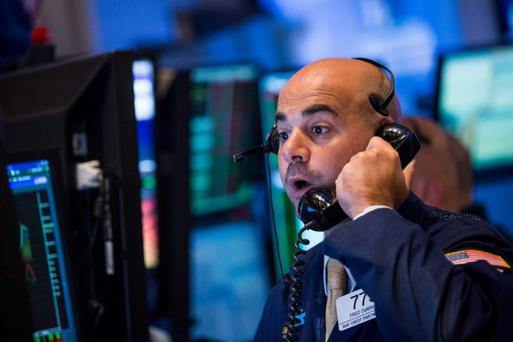 A trader works on the floor of the New York Stock Exchange. Photo: Getty.