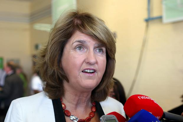 In the Dail yesterday Ms Burton said a family of four adults will pay less than €200 per year in water charges