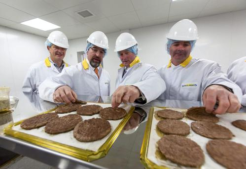 McDonald's Jose Armario, left, and Taoiseach Enda Kenny at the opening of Dawn Meats' facility in Co Waterford in 2012. McDonald's is one of the processor's bluechip clients