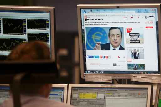 A trader in Frankfurt watches the announcement as all eyes were on ECB president Mario Draghi around Europe yesterday. Reuters
