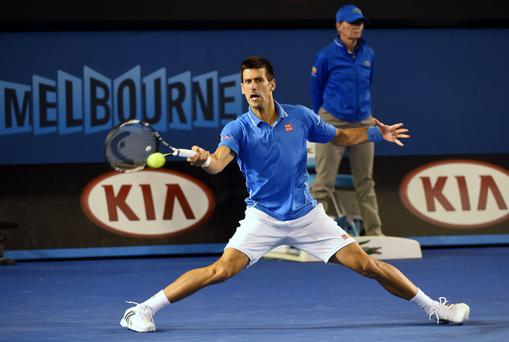 Novak Djokovic hits a return against Andy Murray in the men's singles final of the Australian Open tennis tournament in Melbourne