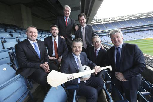 Terry Kroeger, President and CEO, Berkshire Hathaway Media, holding hurley, with (l-r) Enda Buckley, Local Ireland; Sean Mahon, President Local Ireland and Managing Director Southern Star; Eoghan O Neachtain, Eriva; Frank Mulrennan, CEO Media Group; Michael Ryan, Managing Director, INM Regionals; and Johnny O'Hanlon, Local Ireland, in Croke Park yesterday