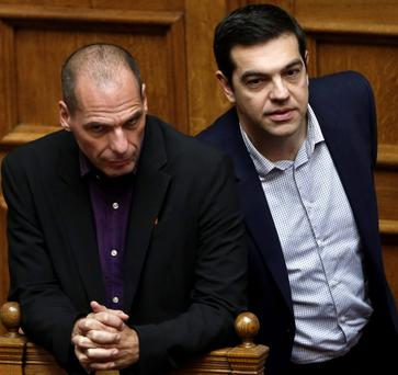 MANDATE: Greek Minister Alexis Tsipras, right and his finance minister Yanis Varoufakis. Photo: Petros Giannakouris/AP