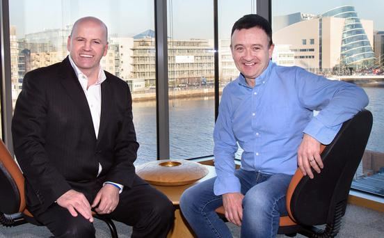 CUTTING EDGE TECHNOLOGY: Sean Gallagher with Realex CEO Colm Lyon at the Realex offices on Sir John Rogerson's Quay. Photo: Tony Gavin