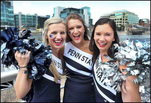 Penn State cheerleaders over here for last year's American football game, now American tourists are getting more value for their dollar in Ireland.